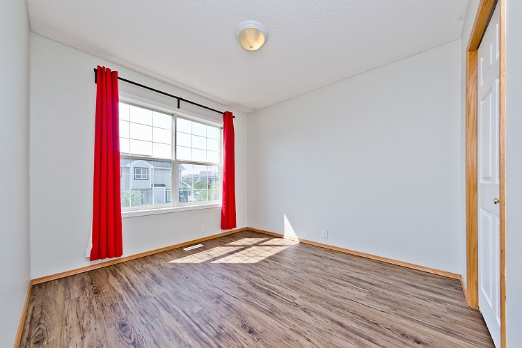 Spacious bedroom in this home for rent in Calgary