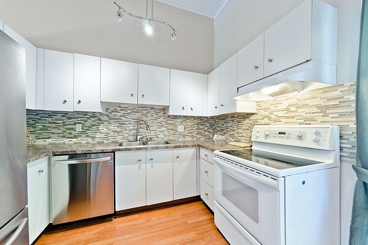 Stainless appliances in White Kitchen